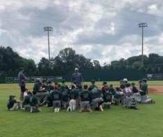Coach Moore speaks to middle schooler